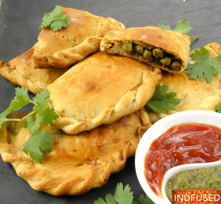 Indian fusion recipe for savory hand pies made with a scrumptious green pea filling with Indian spices