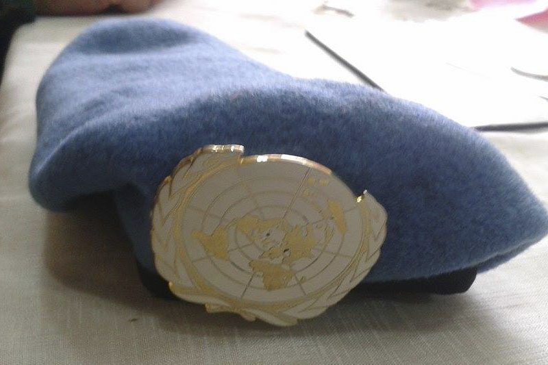 Boina azul, que representa a la Organización de las Naciones Unidas