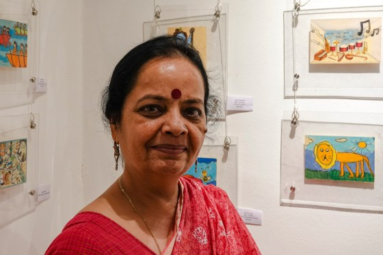 kathak dancer Prerana Shrimali with children's paintings at Khula Aasmaan exhibition