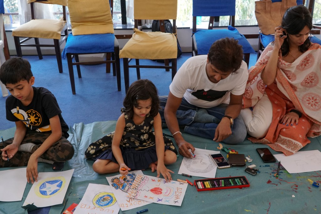 Kids and parents painting together at Khula Aasman art workshop