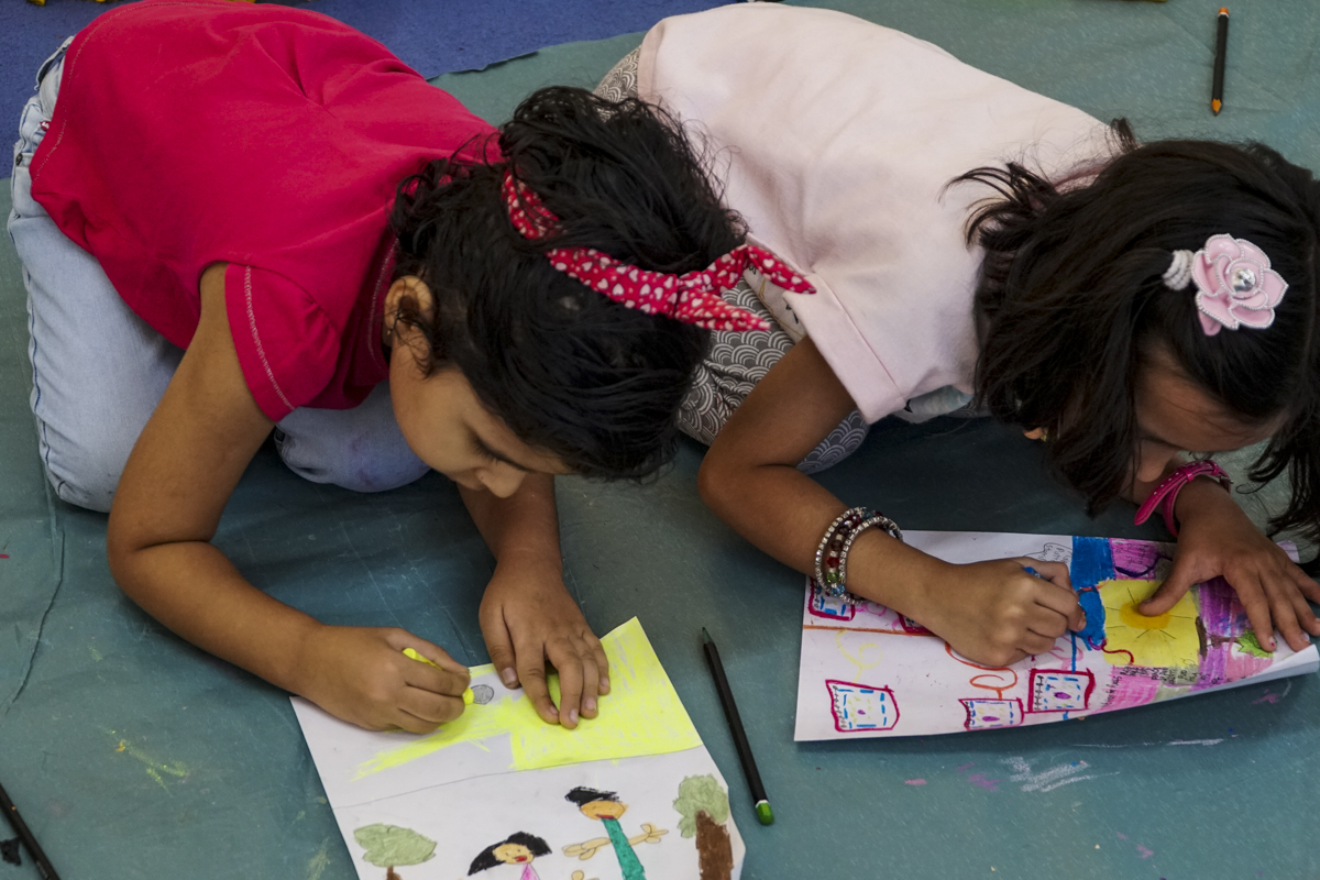 Two girls engrossed in painting at Khula Aasmaan workshop