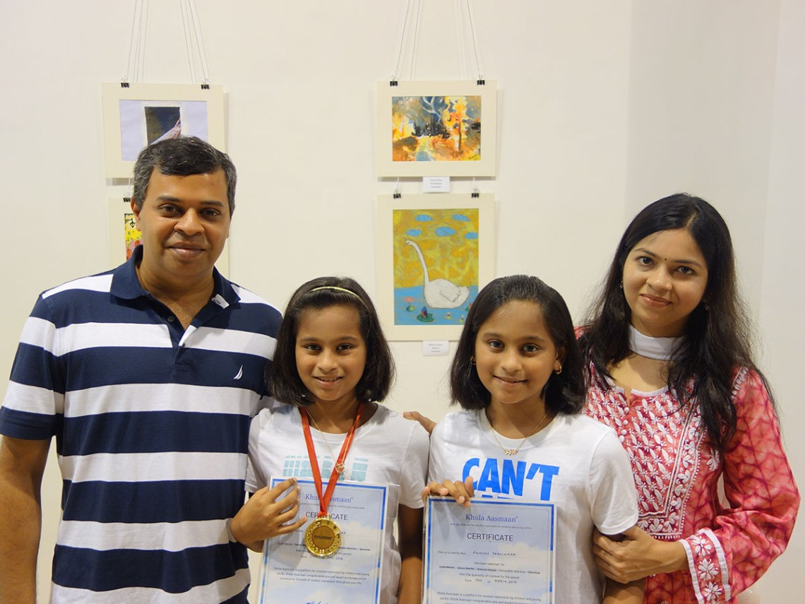 Mihika and Anushka Parulekar with parents at Khula Aasmaan art exhibition of medal winning artworks at Mumbai - October 2017