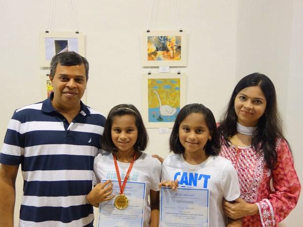 Mihika and Anushka Parulekar with parents at Khula Aasmaan art exhibition of medal winning artworks at Mumbai - October 2017