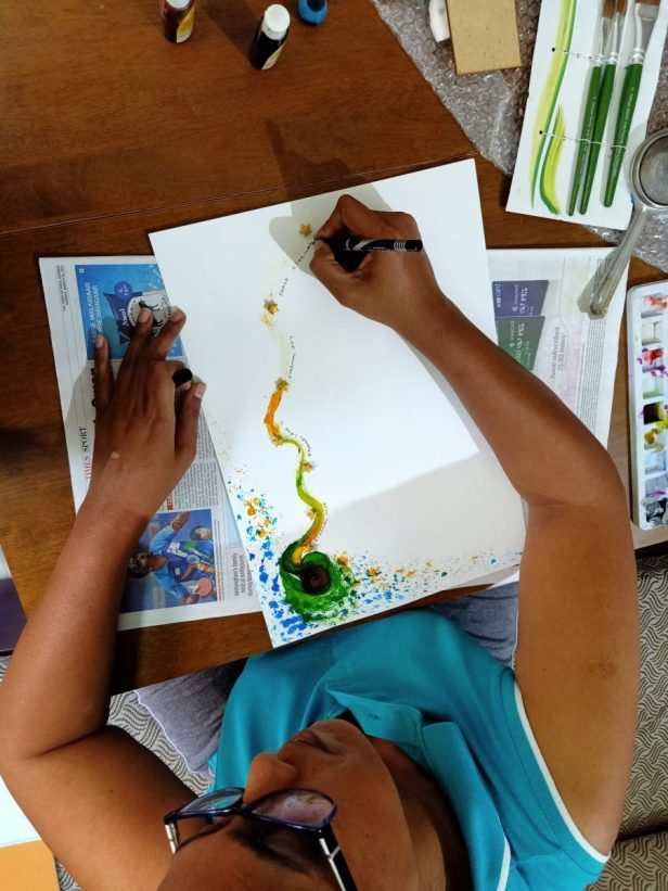 """Karen D'lima about to finish her artwork on day 1 of lockdown - part of """"Art in the time of coronavirus - hope and positivity through creativity"""""""