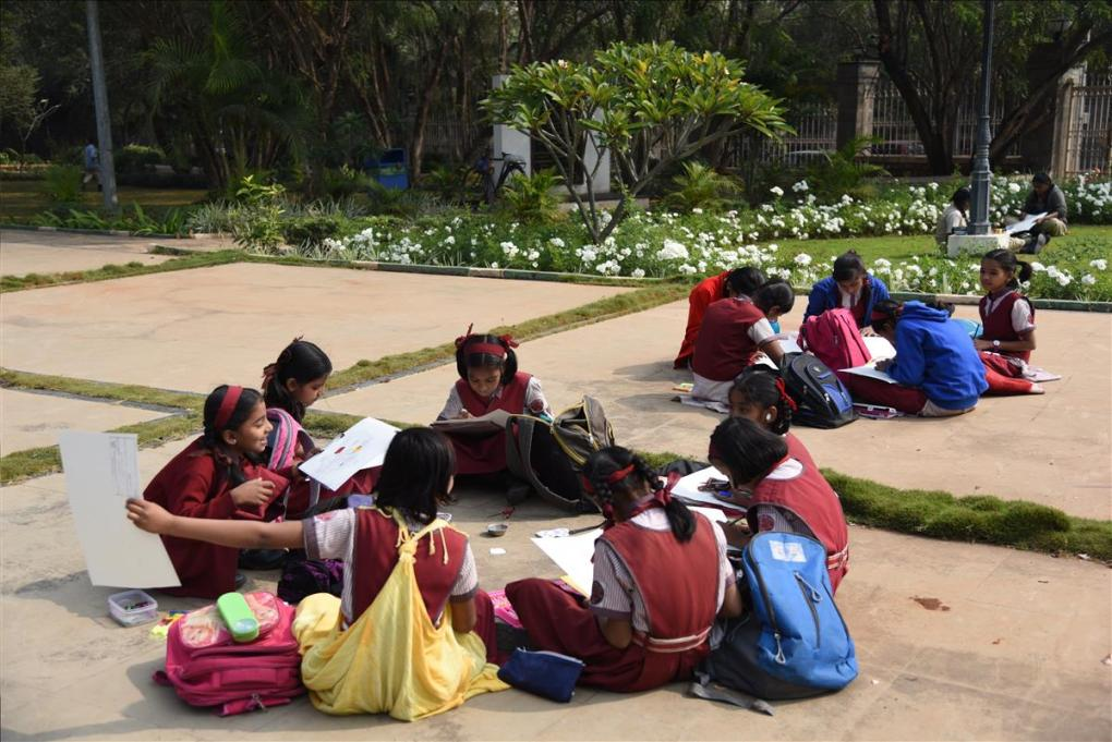 children enjoy the painting session at university garden