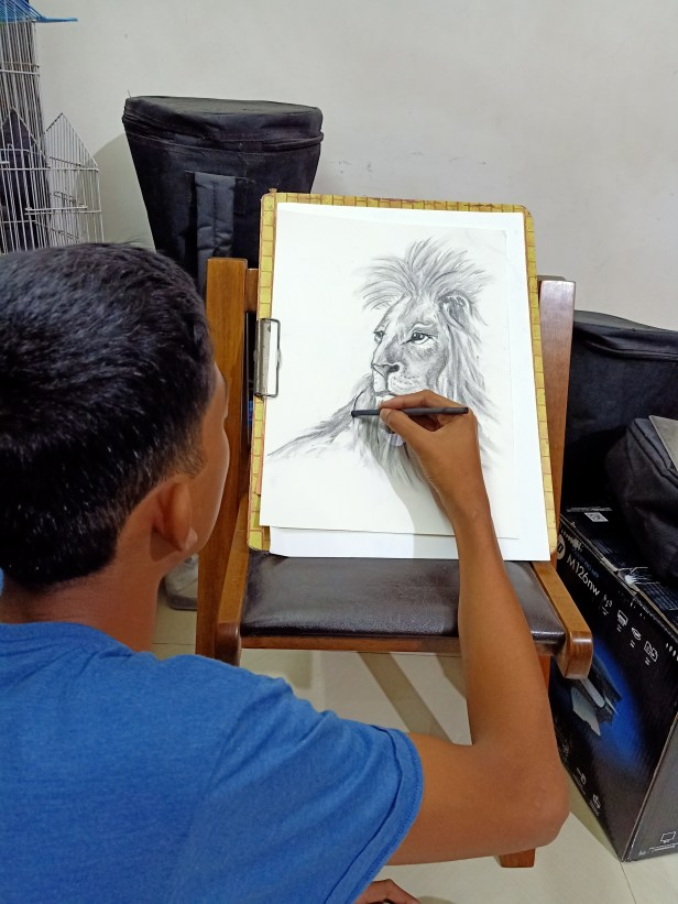 Jude D'lima sketching with charcoal during the national lockdown for art project during coronavirus pandemic