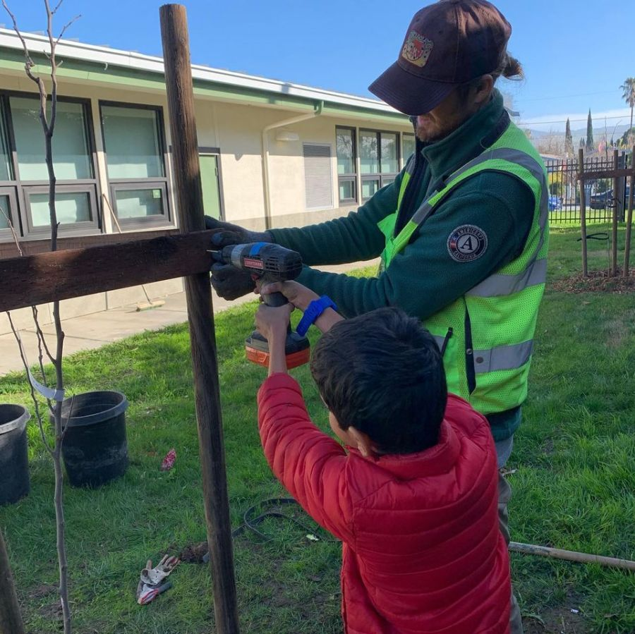 Kids participate in tree planting with Our City Forest in the Bay Area