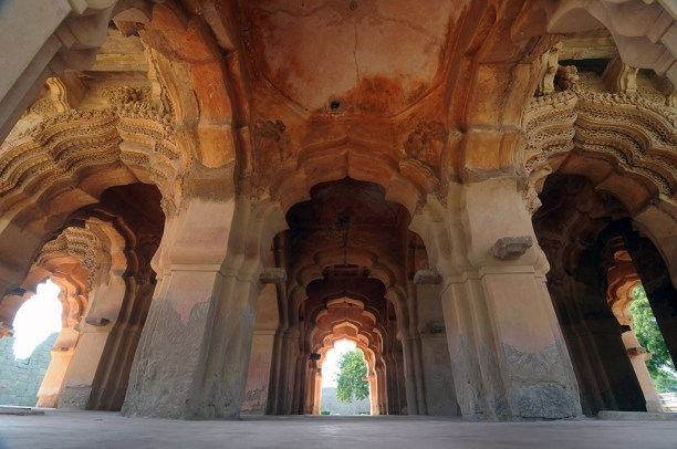 The arched openings of the two-storied Lotus Mahal.