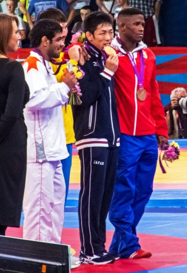 Medalists at the 2012 Summer Olympics. Left to right: Sushil Kumar (silver), Akzhurek Tanatarov (bronze), Tatsuhiro Yonemitsu (gold) and Liván López (bronze). (Image by Akira Kouchiyama on Flickr and under Creative Commons License 2.0)