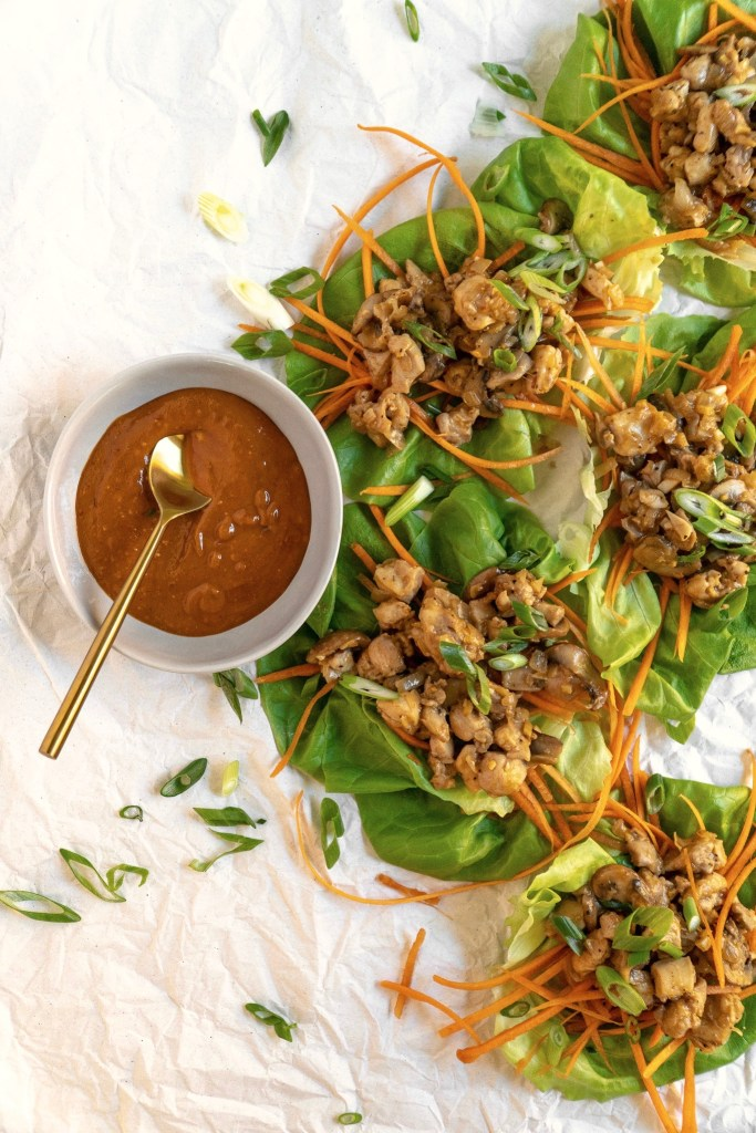 Peanut Chicken Lettuce Wraps with Mushrooms and Carrots with a side of Peanut Sauce to drizzle over lettuce wraps