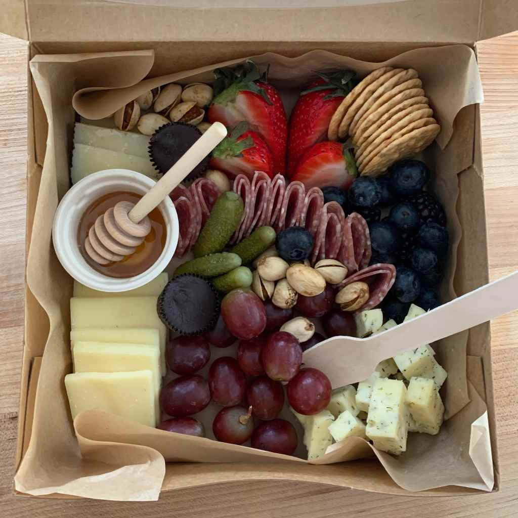 Box filled with delicious charcuterie from Board and You in Indianapolis