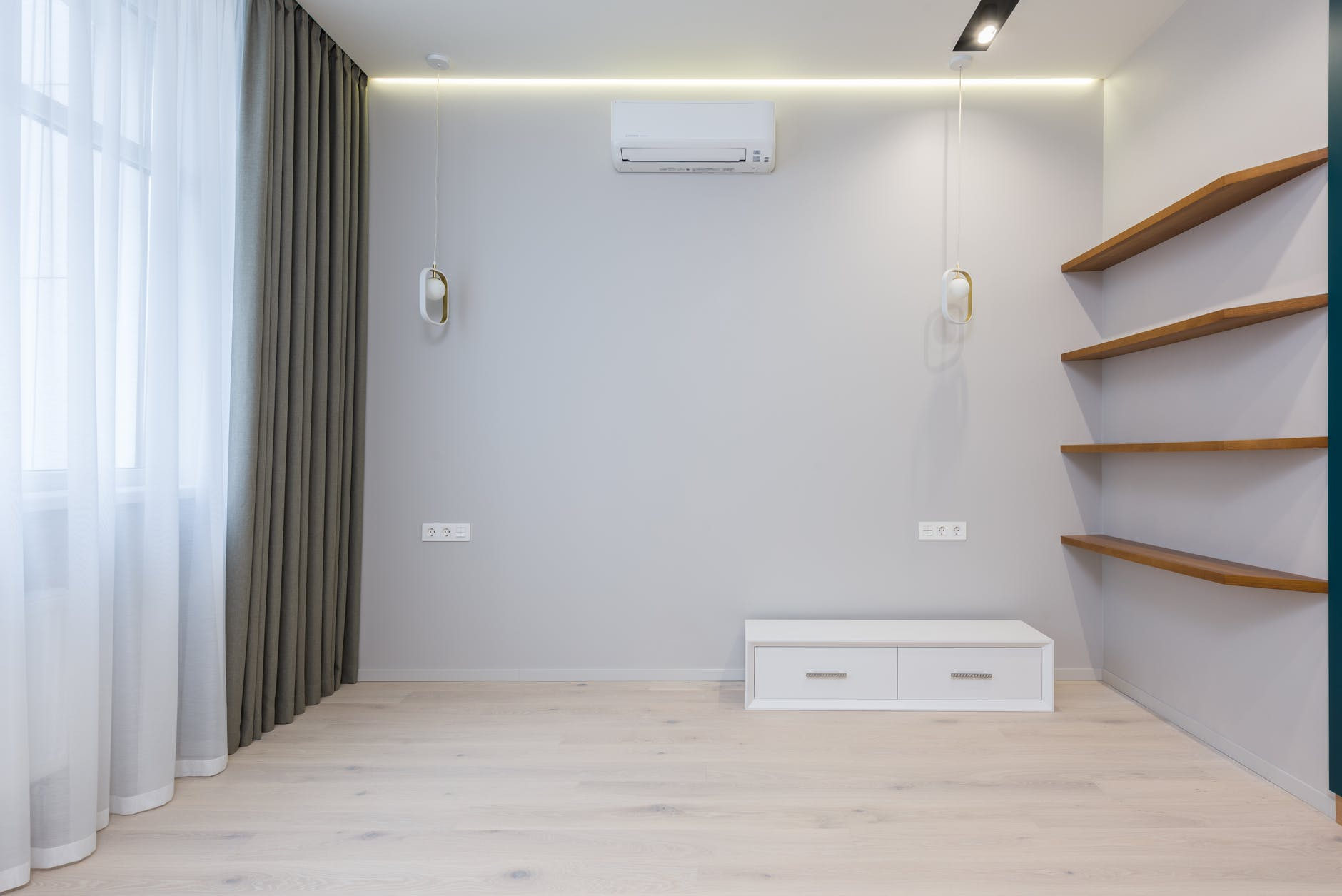 interior of minimalist room with wooden shelves and ac