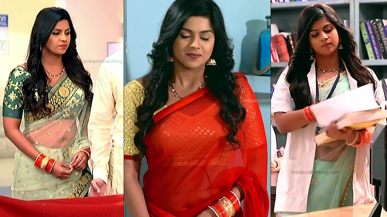 Swarda Thigale shows off navel in transparent saree