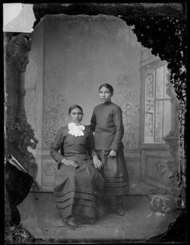 This photo, taken about 1880, shows Dora Her Pipe (Brave Bull), Rosebud Sioux, seated, with Fanny Knife Holder, Kiowa. Dora arrived at the school at age 16 on Oct. 6, 1879, with the first group of students from Rosebud and Pine Ridge. She died of what was believed to be pneumonia on April 24, 1881. Fanny, 10, arrived a few weeks later, on Oct. 27, 1879, but left the following August in ill health, according to school records. (Photo courtesy of the Cumberland County Historical Society)