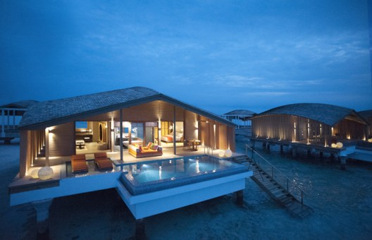An overwater villa at Club Med Finolhu island resort in Maldives.