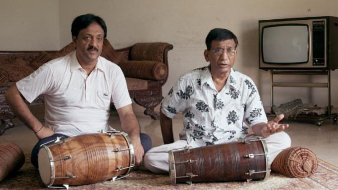 "In ""Song of Lahore,"" dholak player Najaf Ali (Left) is seen learning at the feet of his father Rafiq Ahmed (Right), as he has since he was six years old."