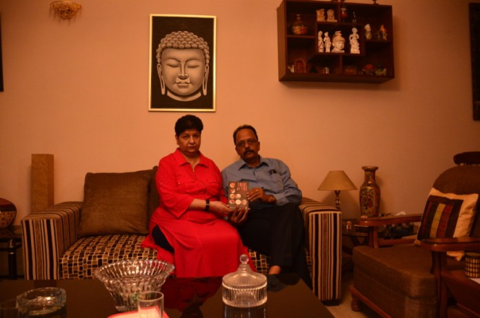 """Neelam and Shekhar Krishnamoorthy with their book \""""Trial by Fire\""""."""