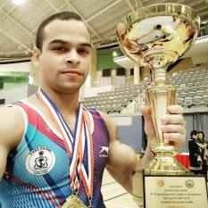 Rakesh Kumar Patra with his all around trophy and Rings and Parallel Bars Gold medals at Hongkong International Gymnastics Championship