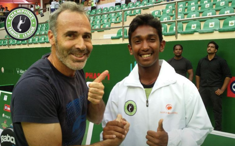 Nitin with Tennis Legend Alex Corretja.png