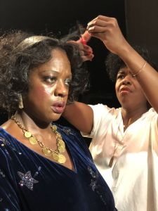 A hair touch-up on the set of Ma Rainey's Black Bottom