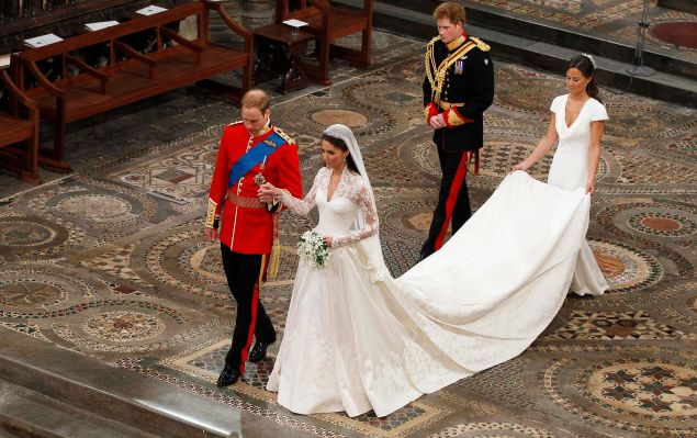 LONDON, ENGLAND - APRIL 29: Prince William takes the hand of his bride Catherine Middleton, now to be known as Catherine, Duchess of Cambridge, followed by Prince Harry and Pippa Middleton as they walk down the aisle inside Westminster Abbey on April 29, 2011 in London, England. The marriage of Prince William, the second in line to the British throne, to Catherine Middleton is being held in London today. The marriage of the second in line to the British throne is to be led by the Archbishop of Canterbury and will be attended by 1900 guests, including foreign Royal family members and heads of state. Thousands of well-wishers from around the world have also flocked to London to witness the spectacle and pageantry of the Royal Wedding.