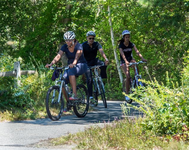 And here the Obamas are on a casual bicycling ride in Martha's Vineyard.