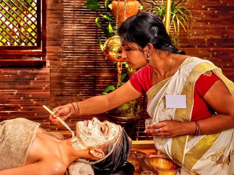 Woman having mask at ayurveda spa