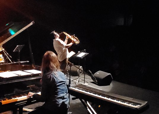 Sofía Ramírez plays tehe grand piano while Gerry Lopez blasts he sax. Ajijic. 8.15.19