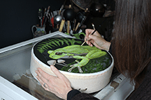 Sharyn Turner painting the Frog Shamanic Drum