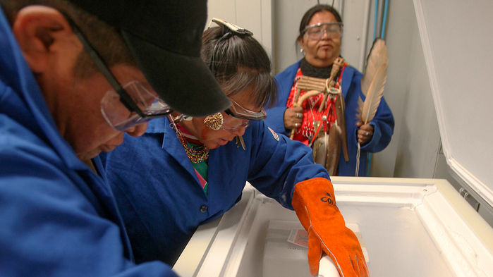 Members of the Havasupai Tribe, shown in 2010 looking at blood samples previously taken from them, had to fight for access to their samples, in an episode that fueled suspicion between scientists and several Native American communities. JIM WILSON/THE NEW YORK TIMES/REDUX