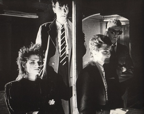 Bauhaus in the music video for She's In Parties