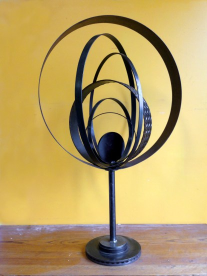 """Reclaimed see, rotor, pipe laser cut disc, strap steel 31"""" W orb, total height 4' H"""