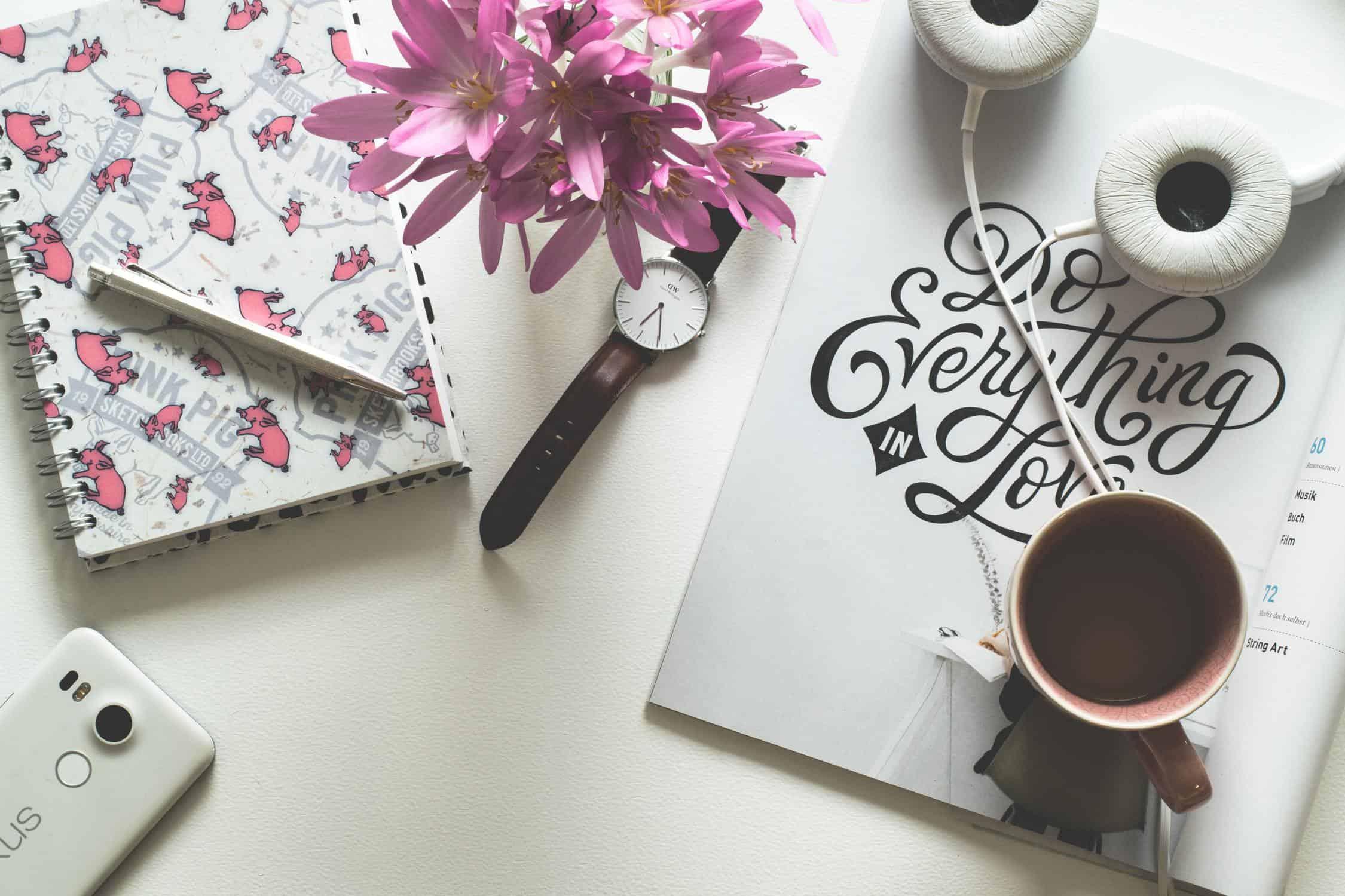 Wordpress Plugin Mistakes Beginner Bloggers Header Image Of Pink Notepad Flowers Coffee Mug And Headphones