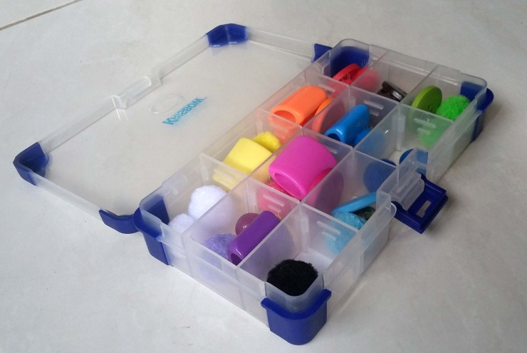 Sorting tray toy with colourful buttons and pompoms