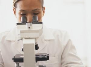 Laboratory technician detecting contaminants