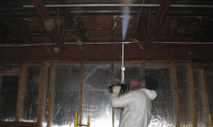 man performs mold remediation in a anaheiem during a mold removal job