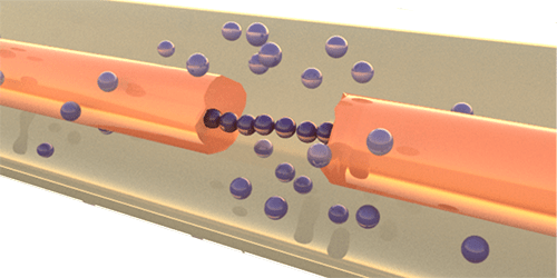 Broken circuit and copper microspheres bridging the gap