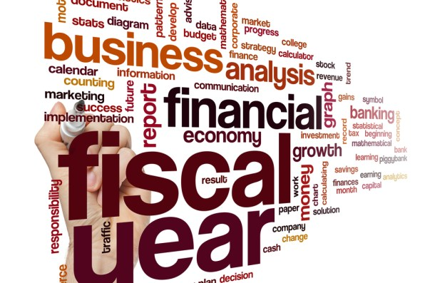 Collage illustration of text featuring terms related to the fiscal year, finance, and business.