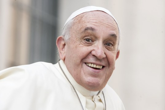 Pope Francis smiles.