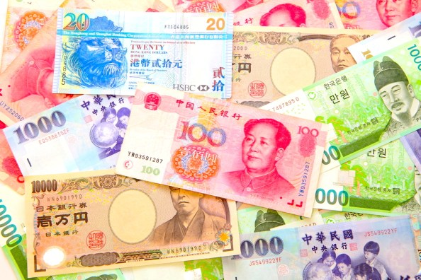 A display of Asian currency representing the work of financial institutions in the region