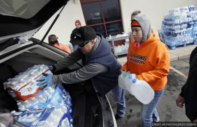 Volunteers distribute bottled water to Flint residents.