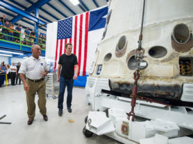 NASA Administrator Charles Bolden, left, and SpaceX CEO and Chief Designer Elon Musk, view the Space X Dragon capsule that returned to Earth.