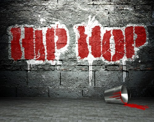 "An image of a grey wall with the worlds ""hip hop"" painted in red."