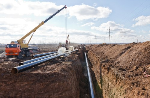A construction site laying down pipeline.