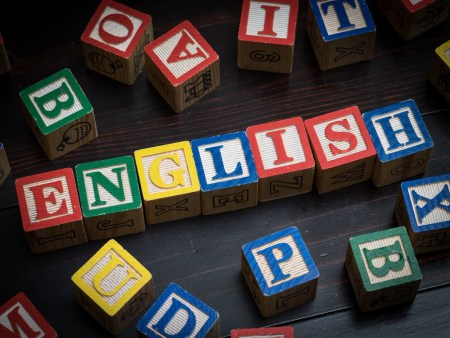 """Children's learning blocks that are arranged to spell out """"English."""""""