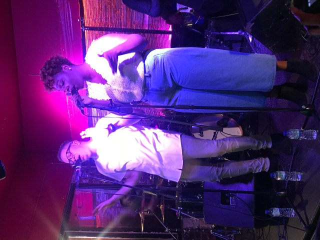 Brother and sister vocals duo DVTN performing at their headline show