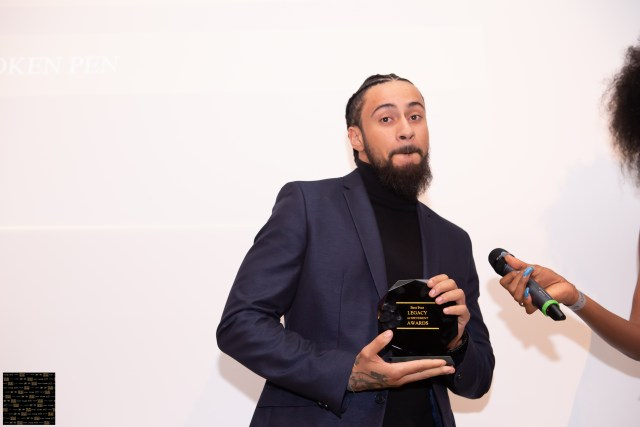 spoken word poet broken pen receiving his award