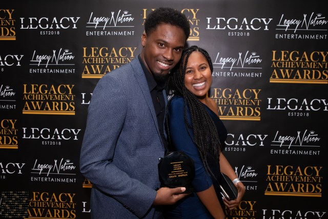 amani Simpson and wife at legacy achievement awards