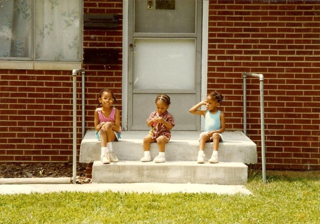Shawnta S. Barnes, in 1st grade, pictured with her younger sisters shortly after her family moved into a home that was within the boundaries of desegregation busing.