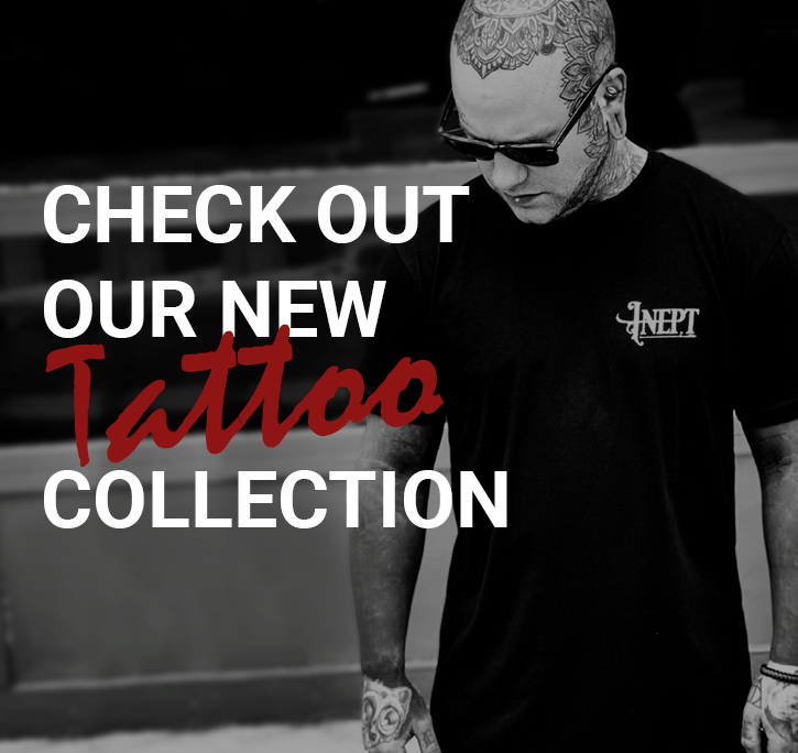 Man wearing black shirt with Inept on the shirt, check out our new tattoo collection